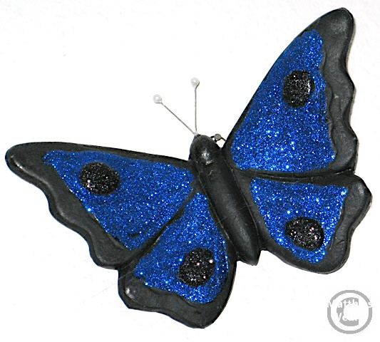 Schmetterling aus Lavtuff schwarz mit blauem Glitzerbelag