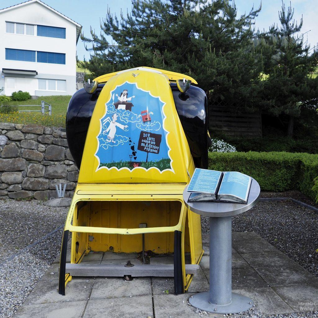 """halbierte Ente Citröen """"CV (Front) hochkant gestellt (gelb/schwarz mit Comic-Motiv blau) und mit Open-Air-Katalog, Oberegg"""